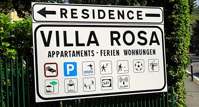 The sign at the entrance of Residence Villa Rosa, in Garda